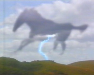 Gwyn sees a huge black horse on the mountainside