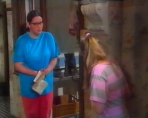 Nerys drops the phone - it is buring she tells Nia