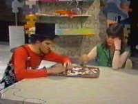 Adrian and Janet try to put together a white peice jigsaw